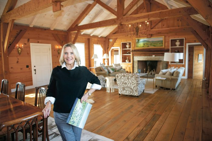 RARE PROPERTY: Mary Philbin, an agent with Mott & Chace Sotheby's International Realty, stands in the great room of a 3,600-square-foot, single-level, clapboard home set on 15 acres, abutted by conservancy land, in the Matunuck village of South Kingstown.  