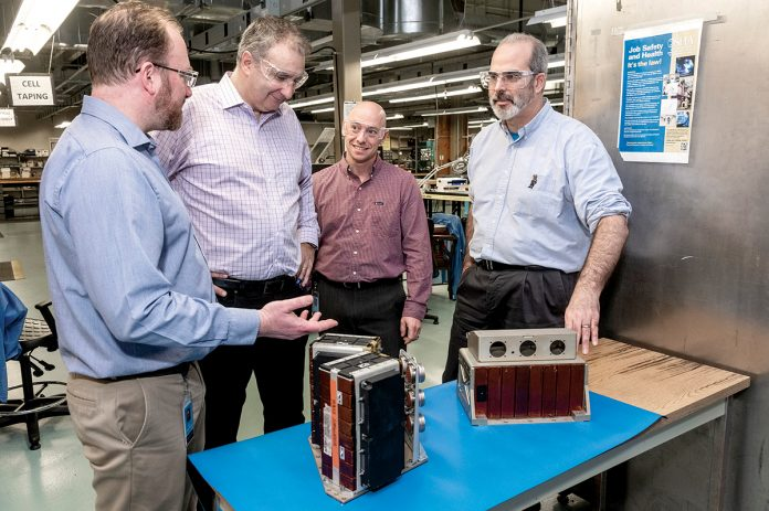POWERFUL BATTERIES: EaglePicher Technologies in East Greenwich develops batteries for spacecraft and military jets. From left, Robert Gitzendanner, applications engineering director; George Cintra, vice president of research and development; Alex Buonanno, program manager; and Frank Puglia, director of research and development.  / PBN PHOTO/MICHAEL SALERNO