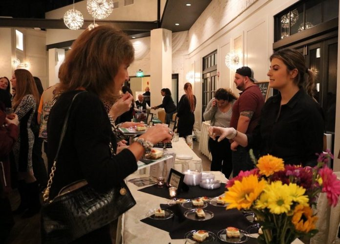 ATTENDEES SAMPLE desserts during the 2018 Girl Scouts of Southeastern New England Cookies & Cocktails event at the Crowne Plaza Providence-Warwick in Warwick. This year's event will be held on March 7 at the Crowne Plaza Providence-Warwick. / COURTESY GIRL SCOUTS OF SOUTHEASTERN NEW ENGLAND