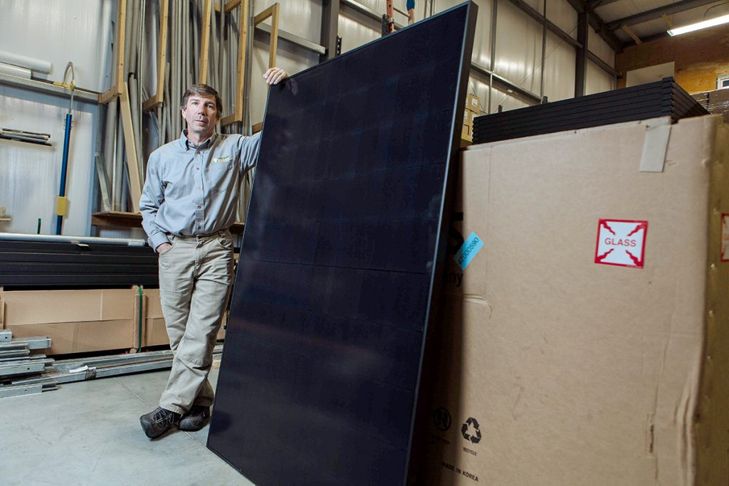 STEADY PRICES: When President Donald Trump announced his plan to levy a 30 percent tariff on imported solar panels, Newport Solar owner Douglas Sabetti, above, invested $200,000 in 1,050 panels, so the anticipated cost increases wouldn't be passed on to his customers. The move allowed the company to keep its prices steady, he said. / PBN PHOTO/RUPERT WHITELEY
