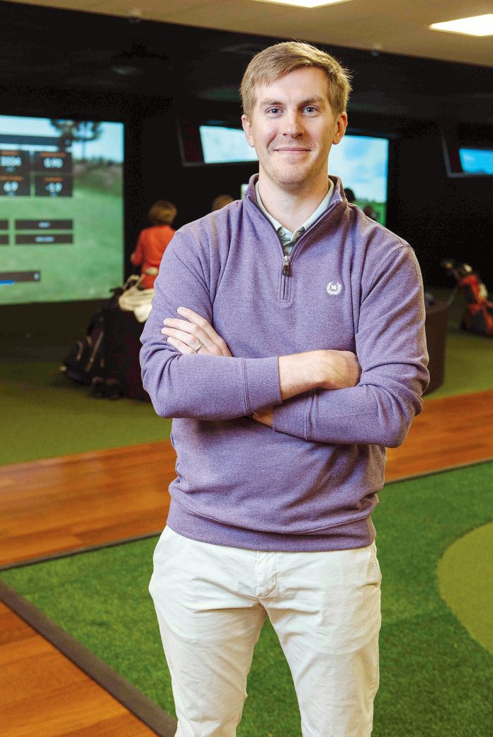AVID GOLFER: Max Buerman is the owner of Newport Indoor Golf, a golfing facility in Portsmouth that features four virtual-reality bays with high-definition projection screens allowing golfers to play courses from around the world.