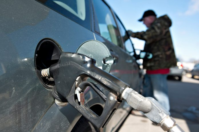 THE AVERAGE PRICE of regular gas in Rhode Island declined 1 cent this week to $2.31 per gallon. / BLOOMBERG FILE PHOTO/DANIEL ACKER