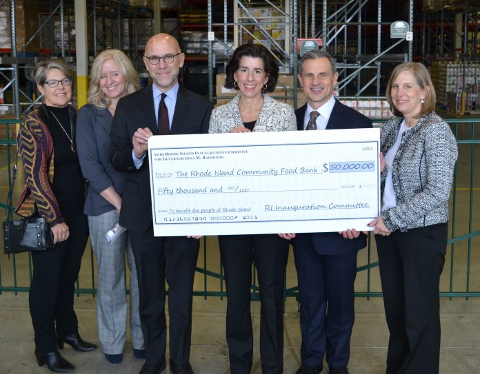 GOV. GINA M. RAIMONDO donates $50,000 raised from her 2019 Inaugural Committee to the Rhode Island Community Food Bank on Wednesday. Pictured, from left: Deborah Thurston, food coordinator for food bank member agency TAPIN; Kate Brewster, executive director for the Jonnycake Center of Peace Dale; Andrew Schiff, food bank CEO; Raimondo; First Gentleman Andy Moffit; and Lisa Roth Blackman, food bank chief philanthropy officer. / COURTESY RHODE ISLAND COMMUNITY FOOD BANK