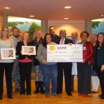 "HASBRO CHILDREN'S HOSPITAL leadership receives a $103,066 donation from Spirit Halloween representatives on Jan. 22. The funds, raised through the retailer's ""Spirit of Children"" program, will benefit the hospital's Child Life program. / COURTESY HASBRO CHILDREN'S HOSPITAL"