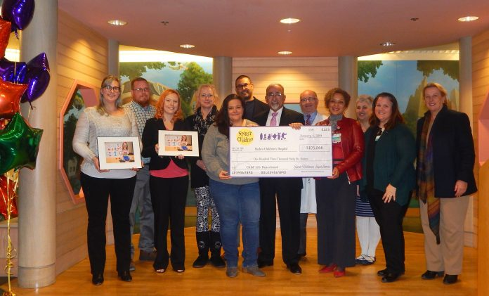 HASBRO CHILDREN'S HOSPITAL leadership receives a $103,066 donation from Spirit Halloween representatives on Jan. 22. The funds, raised through the retailer's