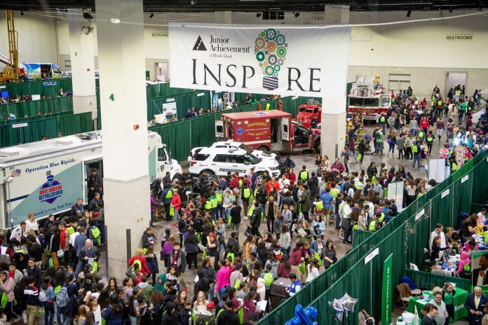 STUDENTS AND STAFF visit exhibits of businesses at the Junior Achievement of Rhode Island's JA Inspire Career Fair at the R.I. Convention Center in December 2018. / COURTESY JUNIOR ACHIEVEMENT OF RHODE ISLAND
