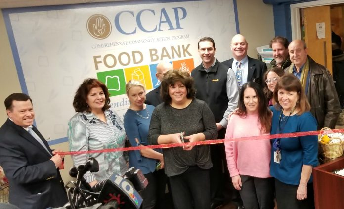 COMPREHENSIVE COMMUNITY ACTION Program staffers, Rotary Club of Cranston members and a representative of Shaw's Supermarket gather Tuesday to cut the ribbon on CCAP's newly expanded food bank at the nonprofit's office in Cranston. / COURTESY COMPREHENSIVE COMMUNITY ACTION PROGRAM