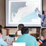 SEAFOOD DISCUSSION: Kevin D.E. Stokesbury, professor at the University of Massachusetts Dartmouth School for Marine Science & Technology, shares a presentation during last year's International Seafood Buyers Luncheon. 