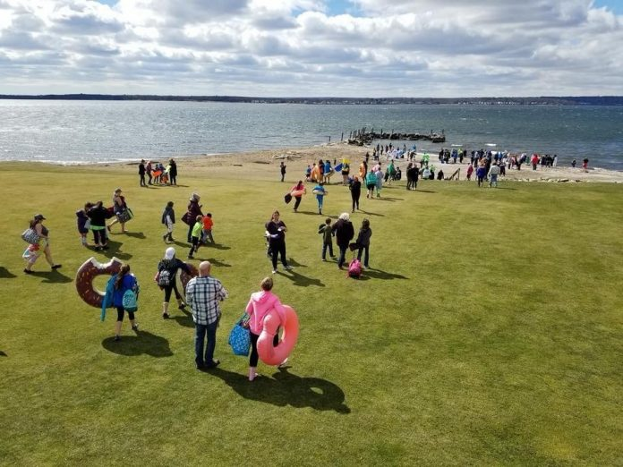 PEOPLE MAKE THEIR way to the water at Narragansett Bay to take a cold swim during the 2018 Project Sweet Peas Plunge for Preemies. This year's plunge will be held on March 9 at Warwick Country Club. / COURTESY PROJECT SWEET PEAS