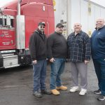 FAMILY TRUCKERS: Commodity Haulers Express is a regional truckload transportation company based at Quonset Business Park. From left, Dan Izzi, James Izzi Jr., their dad, James Izzi, and his brother Robert P. Izzi, the business's founder and owner.
