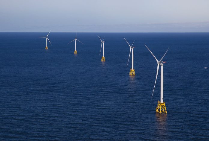 SPINNING NOWHERE? The Block Island Wind Farm may have been the first offshore energy project to start operations in the United States, but the benefits that it promised Rhode Island have yet to materialize.  / BLOOMBERG NEWS FILE PHOTO/ERIC THAYER