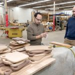 FILLING A NEED: Joshua Ellison, right, founder of Edge and End, with employee Jason Harritos, oversees an enterprise that helps people with developmental disabilities to have work experiences and hopefully employment through woodworking.