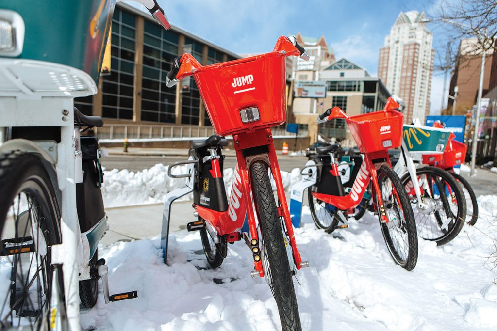BIKE-SHARE: JUMP Bikes are parked at one of several stations throughout Providence. The city contracted with the then-independent company in 2017 to provide bike transportation in the capital city for five years. The bike-share has since been purchased by Uber. / PBN PHOTO/RUPERT WHITELEY