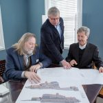 WHAT'S OLD IS NEW AGAIN: Newport Collaborative Architects principals, from left, J. Michael Abbott, John K. Grosvenor and Glenn R. Gardiner go over plans to renovate the Surf Hotel on Block Island into a new complex that will be known as the Block Island Beach House. / PBN PHOTO/KATE WHITNEY LUCEY