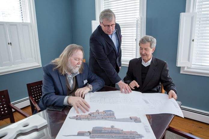 WHAT'S OLD IS NEW AGAIN: Newport Collaborative Architects principals, from left, J. Michael Abbott, John K. Grosvenor and Glenn R. Gardiner go over plans to renovate the Surf Hotel on Block Island into a new complex that will be known as the Block Island Beach House.