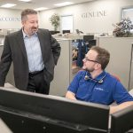 RECRUITING KEY: CEO Rick Norberg, left, speaks with Teddy Kennedy, service desk apprentice, at Vertikal 6 in Warwick. Norberg said the company's full-time apprenticeships have become the key to recruiting and developing employees.