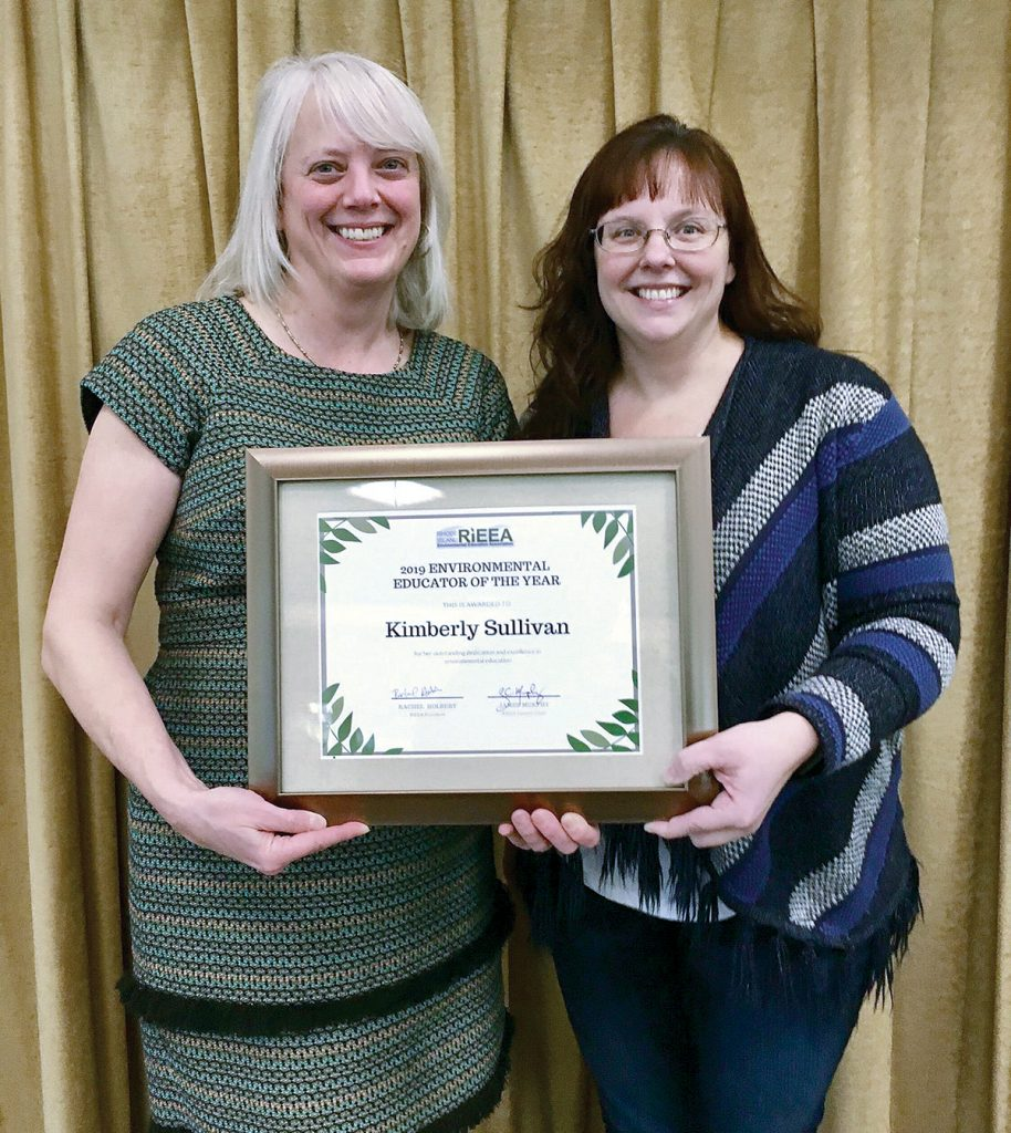 ENVIRONMENTAL EDUCATION: ­Kimberly Sullivan, right, aquatic resource education coordinator for the R.I. Department of Environmental Management's Division of Fish & Wildlife, received the Rhode Island Environmental Education Association's Environmental Education Award. Posing with Sullivan is DEM Executive Director Janet Coit.
