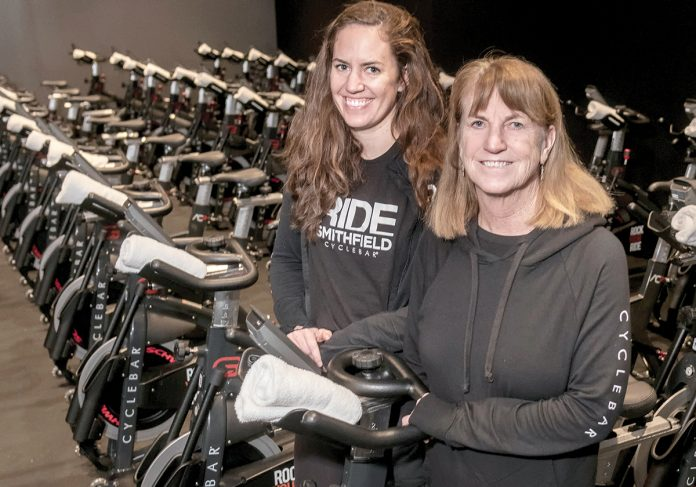 SPINNERS: Claire Hayes, left, and her mother, Sheila Hayes, are the franchise owners of Cyclebar in Smithfield. They opened the franchise after Claire began spinning classes while living in Massachusetts and spoke to her mom about opening a location in Rhode Island.