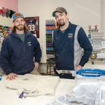 FRESH FRIENDSHIP: Fresh Mode Screen Printing co-owners Jake Fahrenholz, left, and Ethan Colby work on hoodies for a client. The pair became friends at the age of 15, attended college together and opened Fresh Mode in 2006.