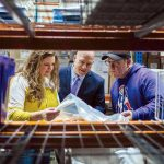 SHIP IT: Supply Chain Manager Daphne Johnstad and Supply Chain Director David Seaback, center, check in with Shipping Manager Peter Reynolds at Amgen Rhode Island's West Greenwich facility.