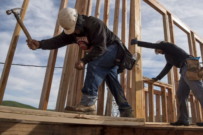 RHODE ISLAND construction employment declined 0.5 percent year over year in February, ranking No. 40 in the nation for percent change in sector employment. / BLOOMBERG NEWS FILE PHOTO