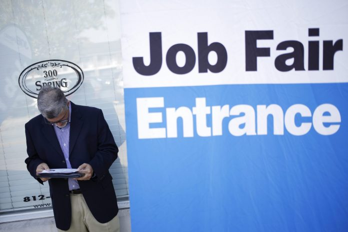 THE UNEMPLOYMENT RATE in the Providence metro area declined 0.5 percentage points year over year to 4.8 percent in January. / BLOOMBERG NEWS FILE PHOTO/LUKE SHARRETT