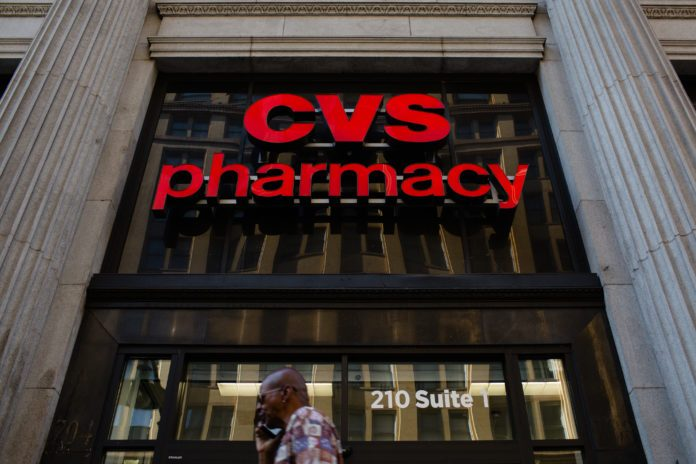CVS Health will begin selling products infused with CBD, a non-intoxicating hemp component, at more than 800 of its stores as part of a distribution deal with marijuana company Curaleaf Holdings. / BLOOMBERG NEWS FILE PHOTO/CHRISTOPHER LEE