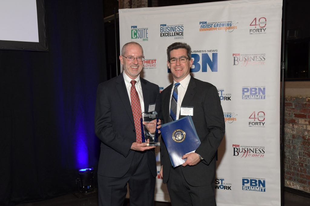 A JOB WELL DONE was the message given to Michael Brandmeier, left, the president and CEO of Toray Plastics America, as he received the plaque marking his award for Leadership & Strategy from Polaris MEP director Christian Cowan at PBN's sixth Manufacturing Awards program. / PBN PHOTO/MIKE SKORSKI