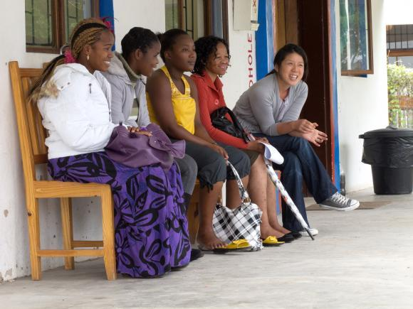 BROWN UNIVERSITY associate professor Caroline Kuo, right, works with a team studying the family dynamics of the HIV epidemic in South Africa. The country is one of the field sites where students in the Global Public Health master's degree program can gain field experience – and is one of the many opportunities at Brown for students to study and research in other countries. / COURTESY BROWN UNIVERSITY/ANDREW NAYSMITH