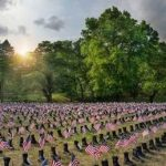 THE BOOTS ON THE GROUND Memorial has been set up annually at Roger Williams Park in Providence since 2015. This year, it will take place at Fort Adams State Park in Newport. / COURTESY OPERATION STAND DOWN RHODE ISLAND