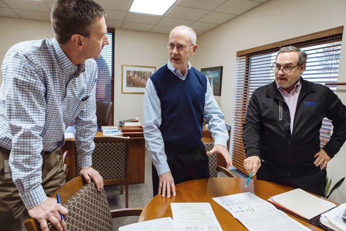 MEETING OF THE MINDS: Toray Plastics President and CEO Michael Brandmeier, center, discusses company business with Chris Nothnagle, left, corporate marketing senior director, and Chief Financial Officer David Jose.