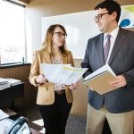 RECENT IMPROVEMENTS: HealthSource RI Director Zachary W. Sherman speaks with Robin Dionne, HSRI chief public affairs officer. Sherman said recent improvements to the HSRI for Employers program include technology advances that have allowed HSRI to connect employers with ancillary products to supplement health and dental plans.