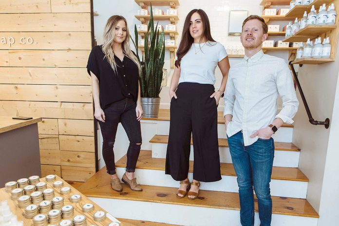 HOMEMADE BEGINNINGS: From left, store manager Brandi White with co-owners Steph and Jake Kopper at Shore Soap in Newport. The Koppers opened the shop at the suggestion of friends and family who were impressed with the couple's homemade 12-bar batches of soap, which began as a hobby.