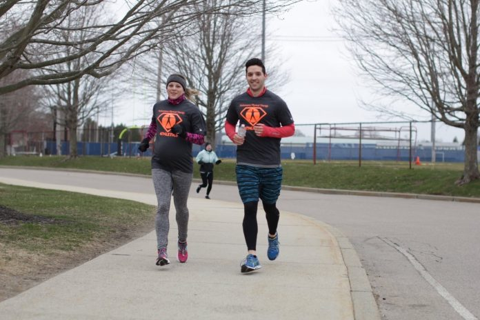A PAIR OF RUNNERS participate during last year's Run For Your Life 5K at the University of Rhode Island. This year's 5K will be held Sunday, April 14, at the university. / COURTESY RUN FOR YOUR LIFE 5K