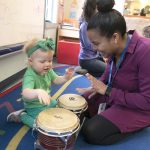 PERCUSSION SKILLS: Meeting Street teacher's assistant Ruth Espinal, right, practices percussion skills with Cameron Cuddy at the Early Learning Center.