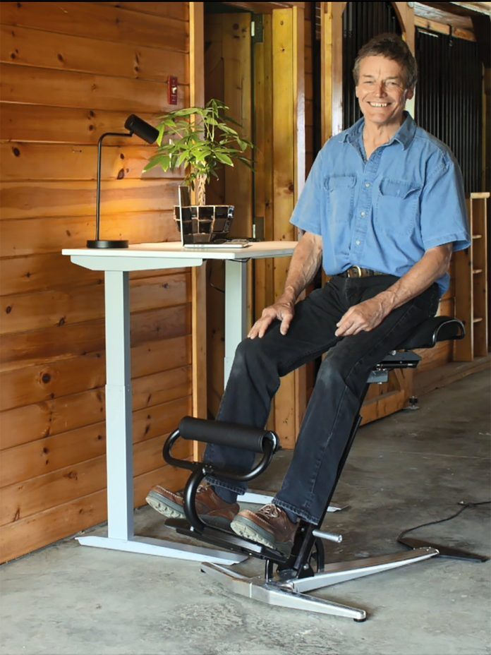 VERSATILE SEAT: Thomas E. Derecktor, founder and CEO of Derecktor Marine Technology LLC, sits on The Fehn, a chair he developed that uses movement to limit workday back pain and fatigue. / COURTESY Derecktor Marine Technology LLC
