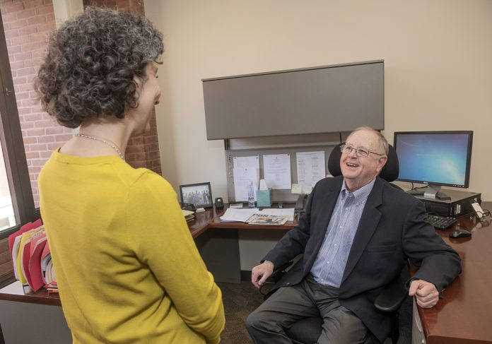 BUSINESS EXPANSION: Thomas Hoagland, executive director of the Providence Business Loan Fund, speaks with Kathy Cosentino, assistant director for business development. 
