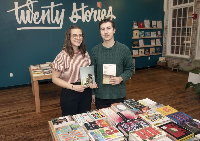 MOBILE BOOKS: Alexa Trembly and Emory Harkins are the co-owners of Twenty Stories, a Los Angeles-born mobile bookselling company that opened a shop in Pawtucket in November.