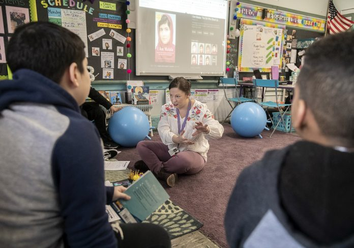 BETTER COMMUNICATION: Karey Bouvier, a fifth grade teacher at Carl Lauro Elementary School in Providence, said she became certified as an English as a second language teacher to better communicate with her students. / PBN PHOTO/MICHAEL SALERNO