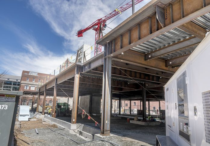POTENTIAL GROCERY STORY: Pictured is the construction site of a six-floor housing project at 78 Fountain St. in Providence, where developers Cornish Associates and Nordblom Co. would like to see a grocery store occupy the ground floor.   / PBN PHOTO/MICHAEL SALERNO