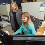 BUILDING HER WAY: Kathleen Bartels, left, principal at LLB Architects in Pawtucket, speaks with Haley Hardwick-Witman, architect. Bartels studied Russian before discovering her love of architecture.