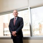 """BIGGER IMPACT: Dr. Timothy J. Babineau, a former cancer surgeon, said he used to care for patients one at a time, but now as president and CEO of Lifespan, """"I take care of them 10,000 at a time."""" / PBN PHOTO/DAVE HANSEN"""