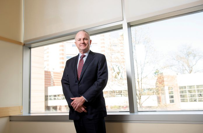 "BIGGER IMPACT: Dr. Timothy J. Babineau, a former cancer surgeon, said he used to care for patients one at a time, but now as president and CEO of Lifespan, ""I take care of them 10,000 at a time.""
