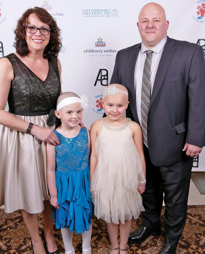 WISH GALA: Emma Zielinski, second from left, and Wish Kid Ella Watters, third from left, pose for a photo with Ella's father, Michael Watters, right, and Ella's mother, Tracy Watters, left, at last year's Children's Wishes Passport Gala. This year's gala, where Emma Zielinski will receive the 2019 Journey Award, will be held on May 10 at Twin River Casino Hotel in Lincoln.