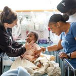SOLE FACILITY: Above, from right, parents Garcel Felisor, father, and Yanida Awlvarado, mother, are pictured with their son, Giovanni E. Felisor, and a nurse at Hasbro Children's Hospital in Providence. Hasbro is the only hospital in New England to perform in-utero surgery and other complex fetal procedures.