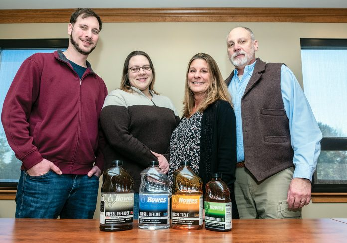NEW LOOK: The Howes family, owners of R B Howes & Co., which has made treatments for both diesel and gasoline for almost 100 years, with some of their rebranded merchandise. Ownership of the company is being transferred from parents Robert B. Howes, right, and Deborah L. Howes, second from right, to their children Robert B. Howes II, left, and Erika B. Howes.
