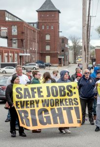 PROTECT WORKERS: Protesters at the Hope Artiste Village in Pawtucket voice their displeasure with a workplace accident that injured three workers about a year ago when an overloaded floor collapsed.  / PBN PHOTO/MICHAEL SALERNO