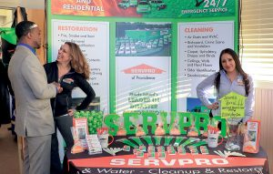 SERVPRO DISPLAY: Heather Chiarello, left, and Andrea Dominguez represent Providence-based fire-and-water-damage cleanup and restoration franchise ServPro at the annual statewide Business After Hours event on March 26 at Rhodes on the Pawtuxet in Cranston. 