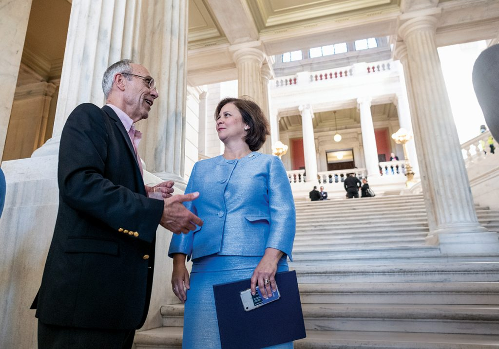 STATEHOUSE GREETING: Secretary of State Nellie M. Gorbea greets Glenn Almquist, senior vice president at Woodard & Curran and member of the Newport County Chamber of Commerce's Government Affairs Committee, on the steps of the Statehouse during the Rhode Island Chamber of Commerce Coalition's annual legislative reception.
