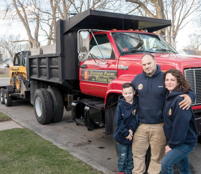SMOOTHING THE WAY: Jason and Justyne Johnson, pictured with their son Tristan, started Statewide Paving and Patching in Warwick in October.  
